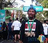 Lutfi Efendi (65) saat berada di garis finish Beautiful Malang Run 2017 (Hendra Saputra/MALANGTIMES)
